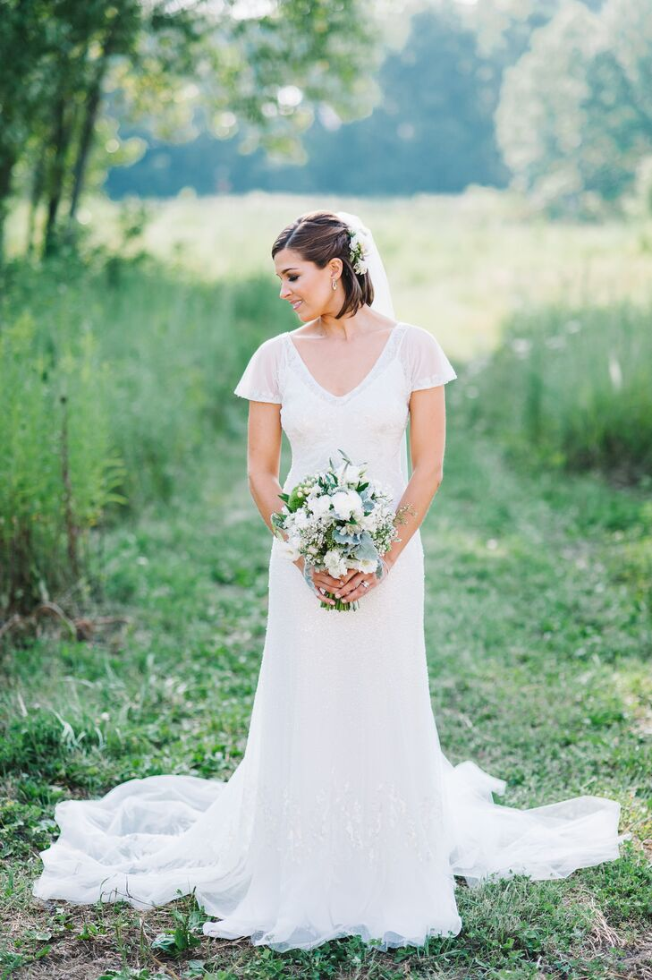 In search of a more natural look, the bride wore her hair half up with a long veil.