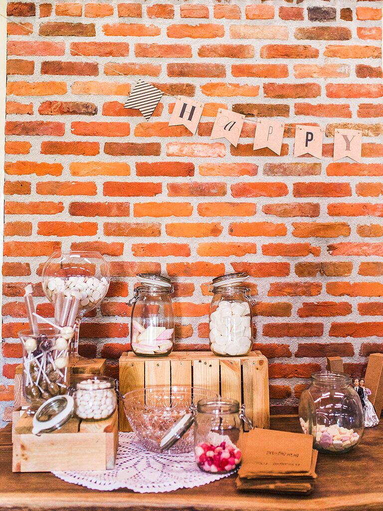 Wedding reception candy bar with rustic wooden decorations