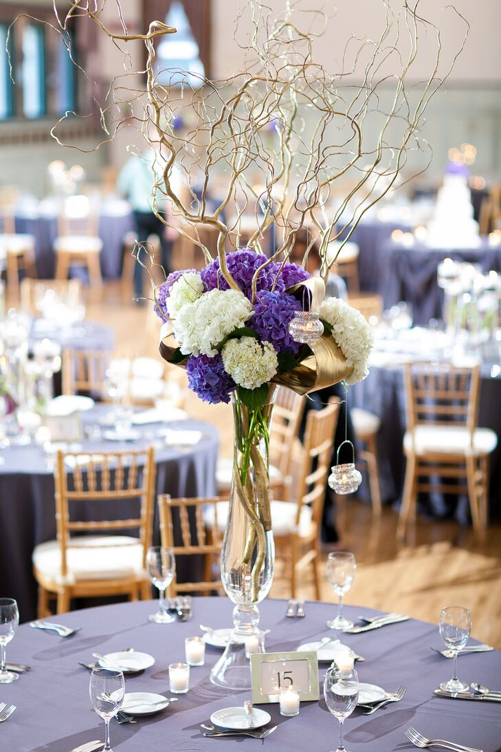 Tall purple hydrangea centerpieces with branches