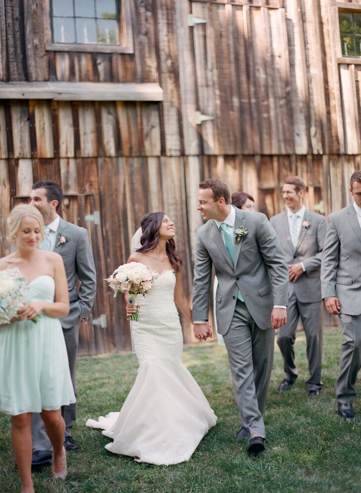 "The bridesmaids wore soft-mint chiffon dresses for the vineyard wedding. ""They were flowy and light for the month of June,"" Andrea says. ""I let them choose if they wanted strapless or one shoulder strap, because I liked the look of a variety of dresses."" The groomsmen wore light gray suits with mint ties."