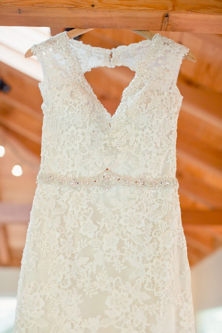 Sophie wore an ivory V-neck wedding dress accented in lace, with a beaded pattern wrapped around the waistline that added a touch of sparkle and an elegant keyhole back.