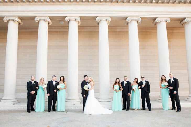 Robin and Matt struck a pose with their wedding party in front of the white columns at the Legion of Honor museum. The long train of Robin's Mori Lee ivory dress elegantly draped behind her throughout the day.