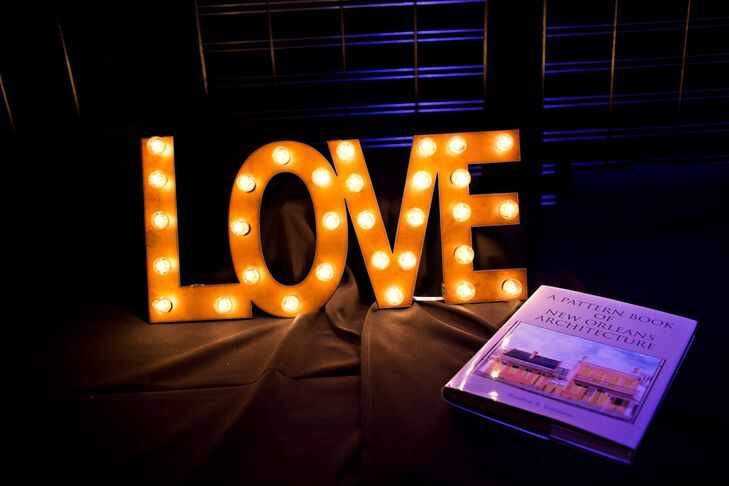"The couple accented their candy bar with a lighted ""Love"" sign."