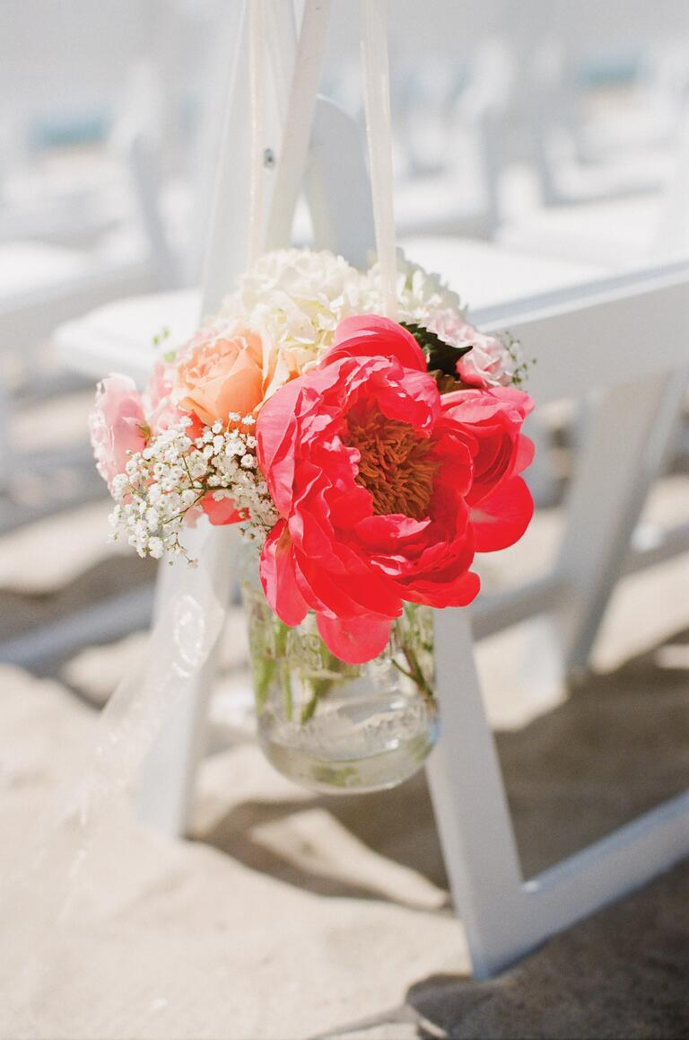 Red peony and baby's breath floral arrangement
