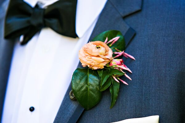 Orange Flower and Leaf Boutonniere