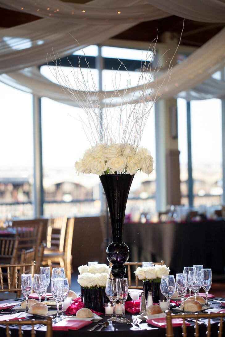 Tall white rose centerpiece in black vase