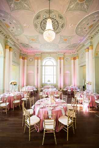 Green and pink wedding reception venue