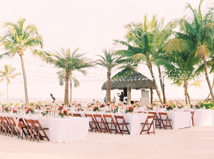 Since they already considered the Caribbean Resort in Islamorada, Florida, their dream venue, only a few pieces of decor were needed to highlight the space. String lights were strewn above the reception. Each one added to the cozy outdoor atmosphere without obstructing anyone's view from the tropical landscape.