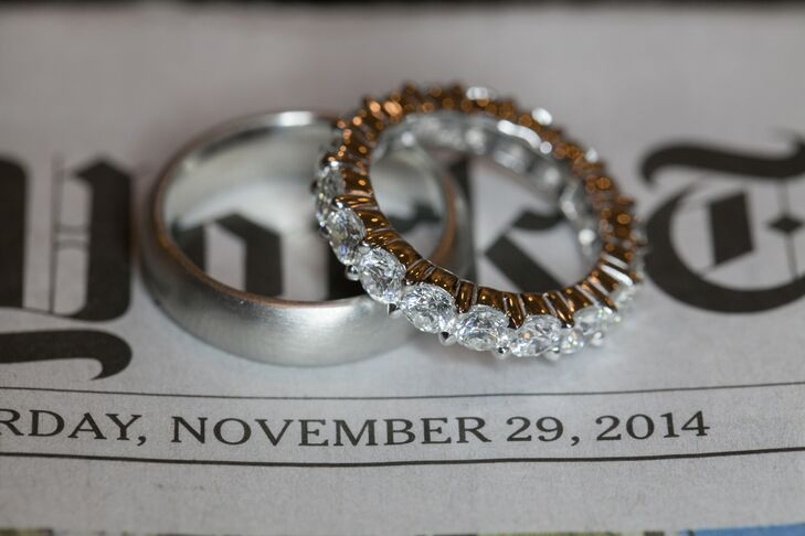 The bride and groom's wedding bands look so pretty set atop a newspaper that shows their November 29, 2014, wedding date. And Rita's diamond engagement band is absolutely breathtaking!