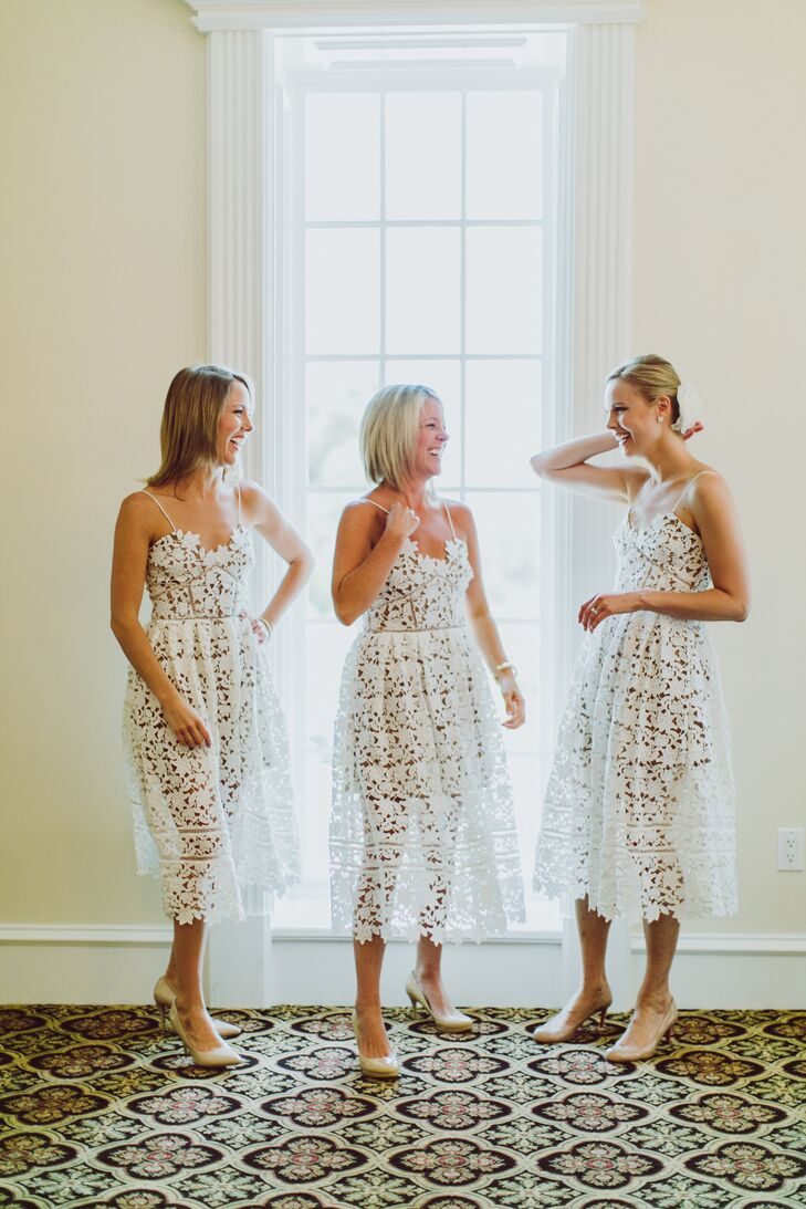 Bridesmaids in white bridesmaid dresses