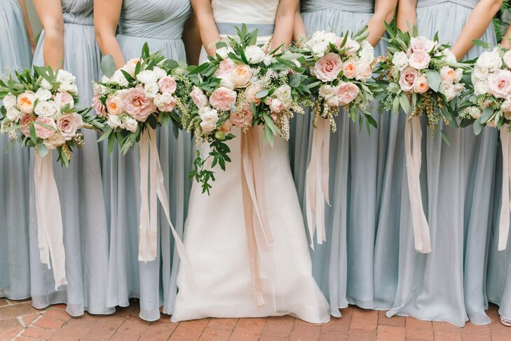 Gavita Flora also designed the bridal party's bountiful bouquets. They mirrored Jauchy's and included white, peach and pink garden roses.