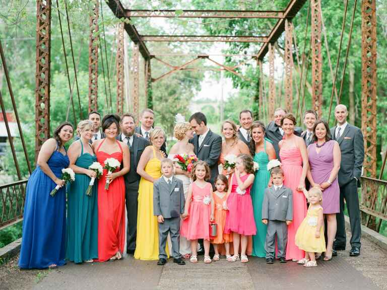 colorful wedding party standing outdoors