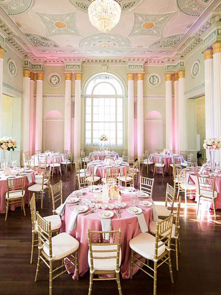 Classic ballroom reception with soft pink uplighting