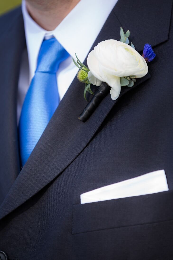 For the groom's boutonniere, florist Anthony Brownie relied on a palette of white and green to offset his navy suit.