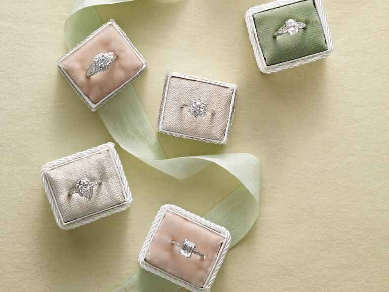 Engagement rings with different settings in ring boxes