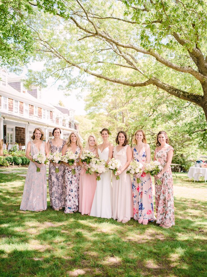 Bridesmaids Donned Long Gowns In An Array Of Fl Prints And Neutral Colors They