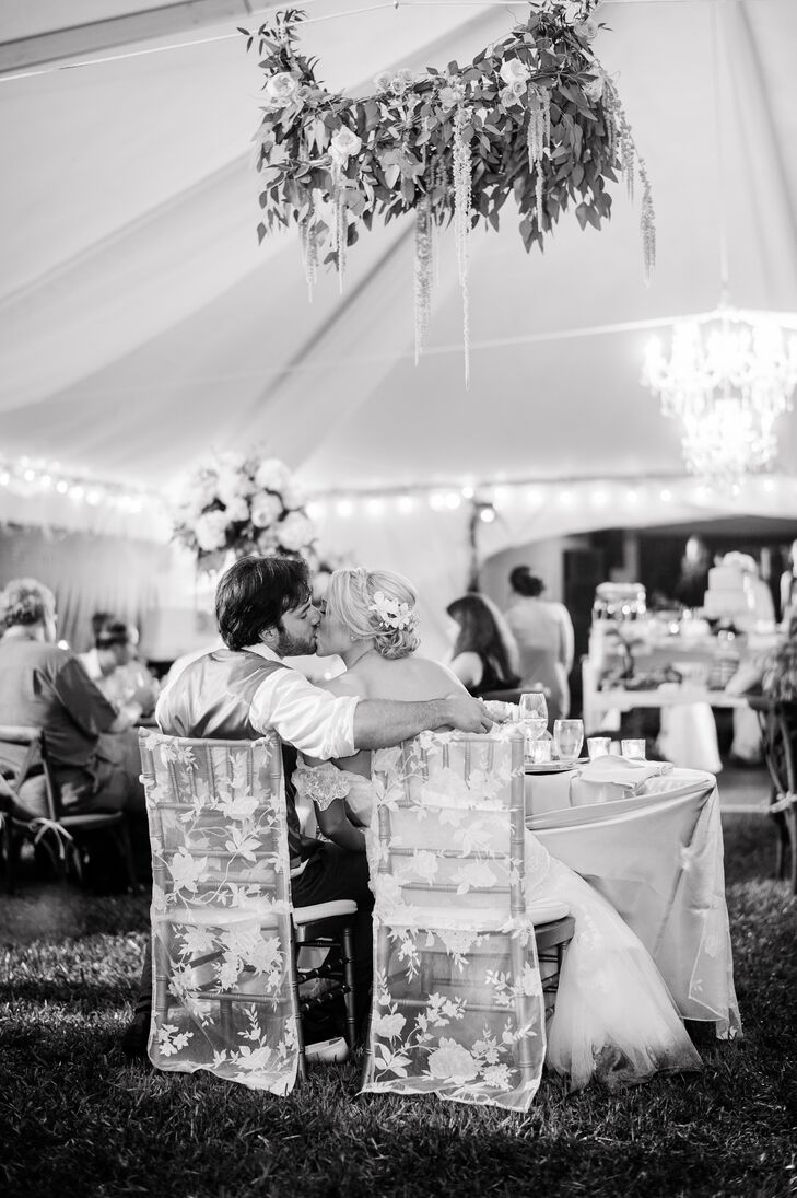 Sweetheart Table Couple with Lace Covered Chairs