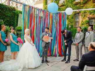 DIY ribbon wedding ceremony backdrop
