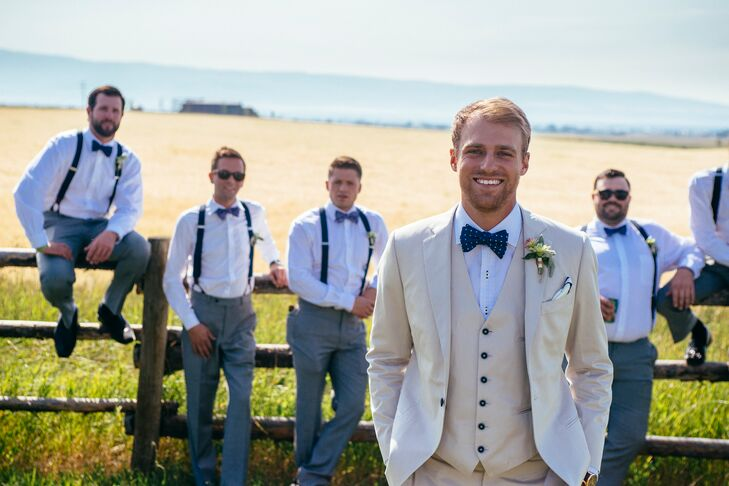 Tan Groom's Suit With Navy Bow Tie