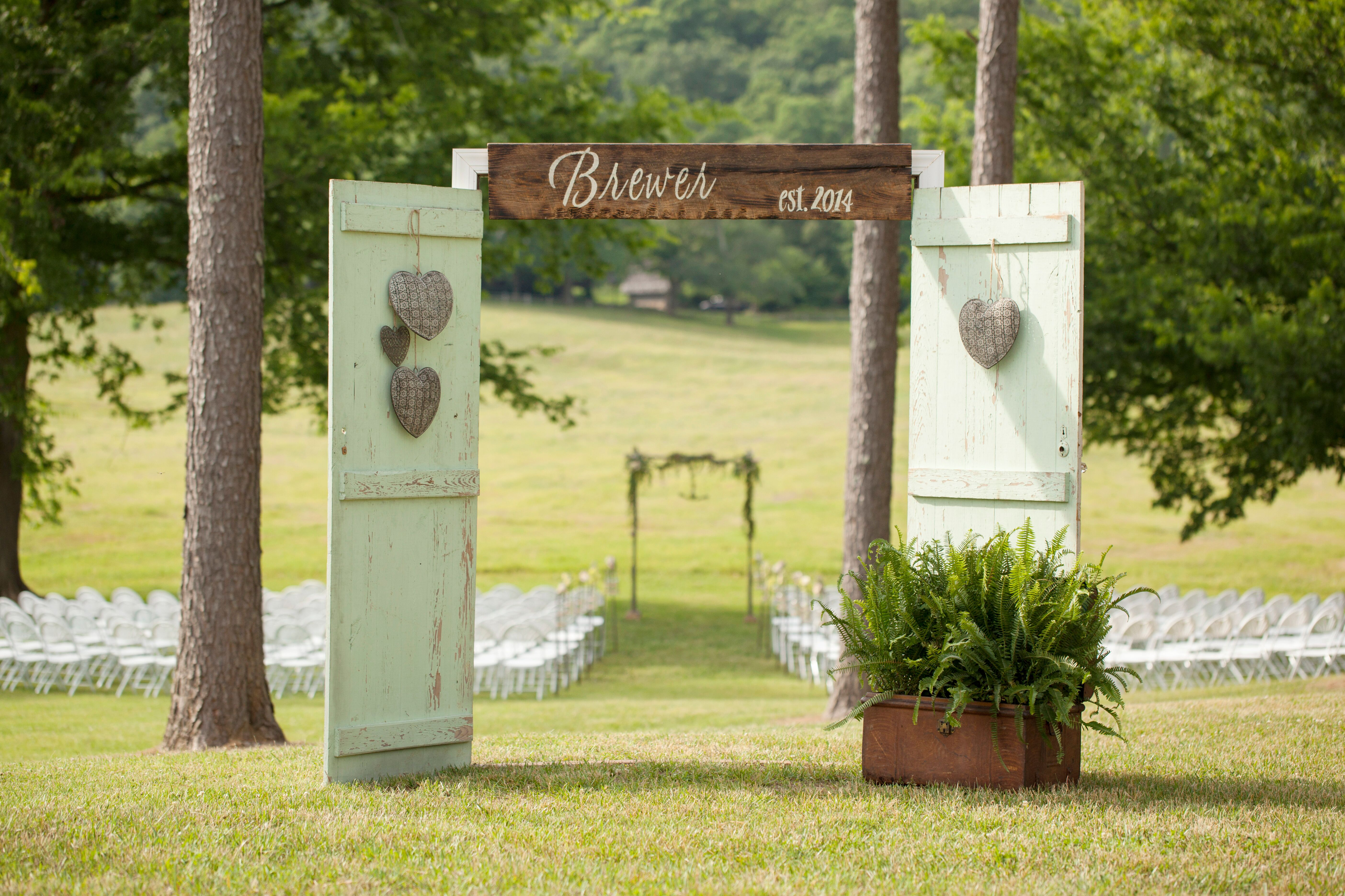 Mint barn door ceremony entrance at sweet seasons farm in for Farm door ideas