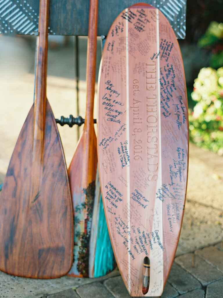 Vintage surfboard guest list at tropical wedding