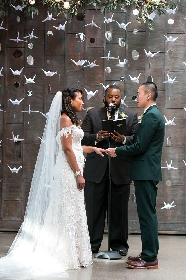 During the ceremony, the couple read personal statements to each other, then recited vows they had written together. They stood in front of a beautiful, handmade crane backdrop.