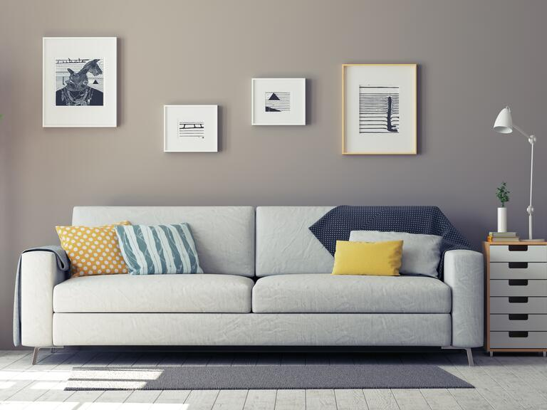 Black and white photographs framed on modern living room wall