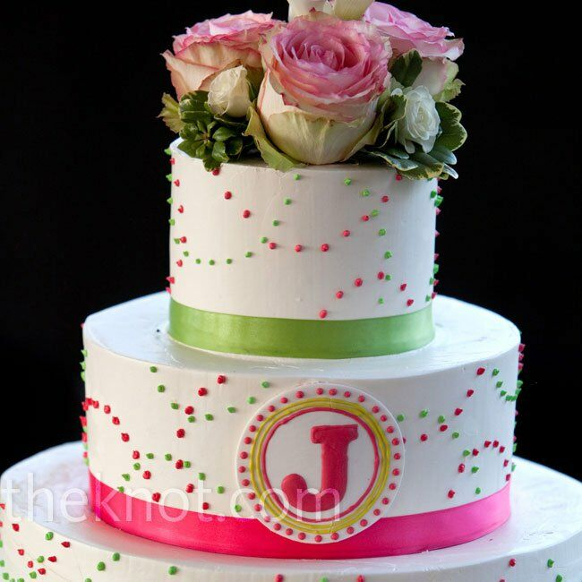 "The cake was spotted with pink and green polka dots and branded with the couple's ""J"" monogram."