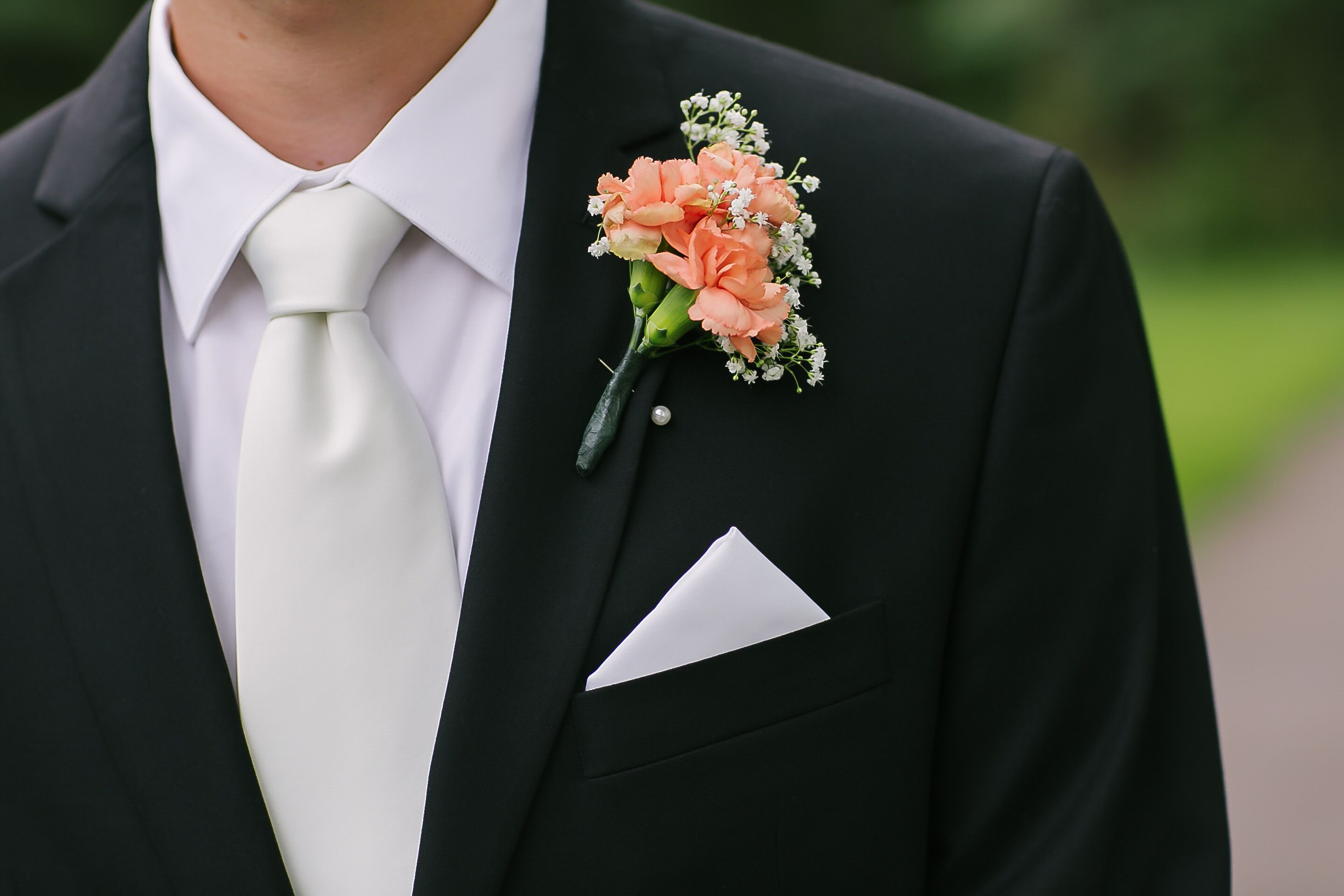 Peach Carnation And Baby S Breath Boutonniere