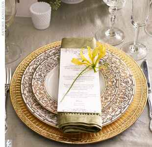 ornate gold plates and charger
