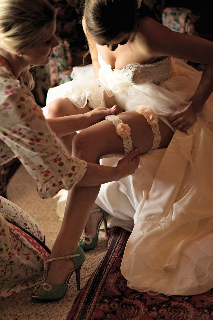When she wasn't wearing rainboots, Noelle wore an elegant pair of jeweled turquoise Bonnibel heels. The bridesmaids wore matching mint green Nina heels to wear inside the dry, hardwood barn.
