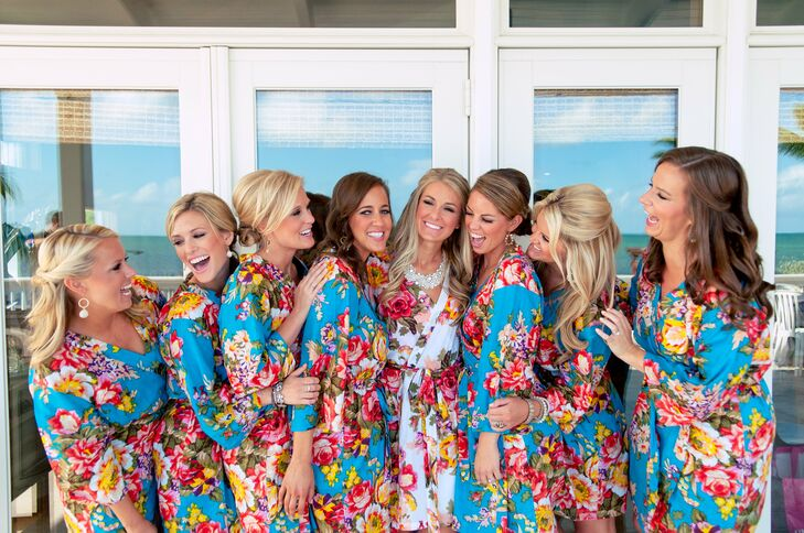 Sarah and her bridesmaids sported bold and comfy floral kimono robes while they got ready for the big day.
