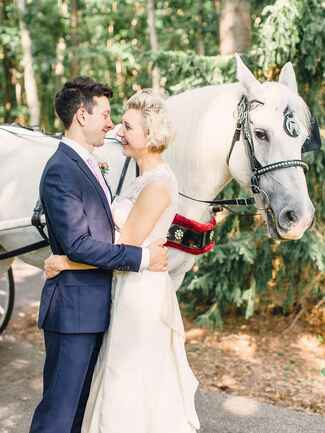 Couple next to horse