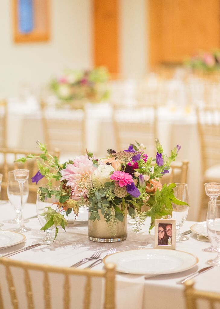 Elegant Pink And Purple Floral Centerpieces In Gold Vases