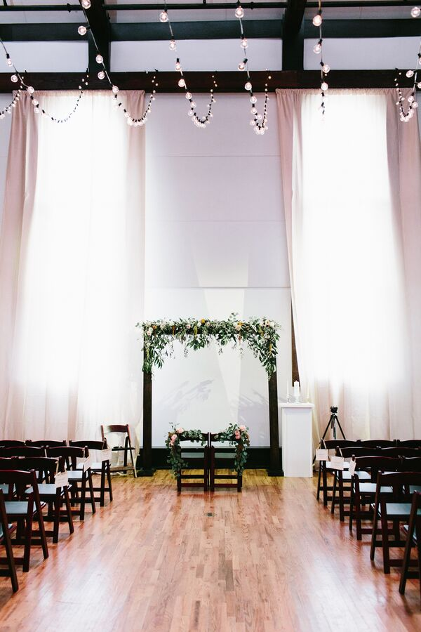 Simple Wood Wedding Arch with Cascading Greenery