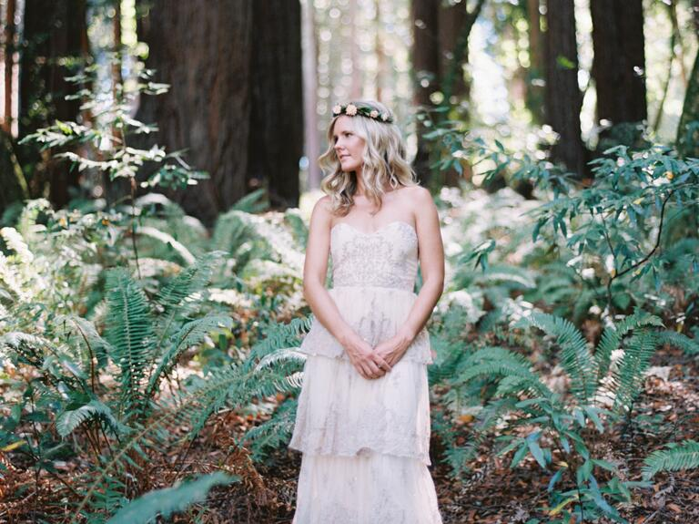 Bridechilla blonde bride with floral headpiece in the woods