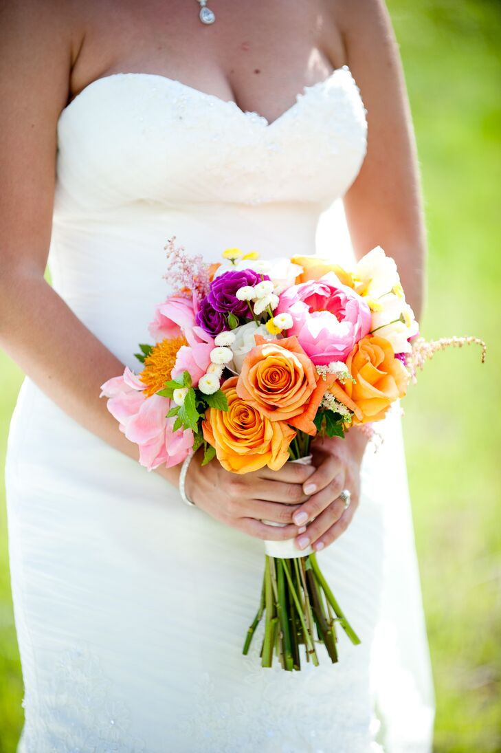 Michelle carried orange roses, pink peonies and plum carnations in her wildflower-inspired bouquet.