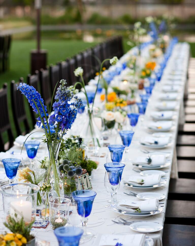 Blue colored glassware at an outdoor wedding reception