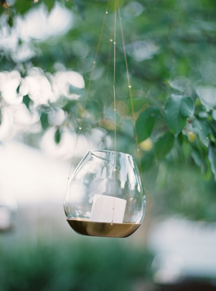 Hanging tealights in small vases adds an ethereal glow to an outdoor wedding and reception in Missoula, Montana.