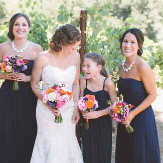 Bridesmaids and junior bridesmaids portrait with bride at vineyard wedding
