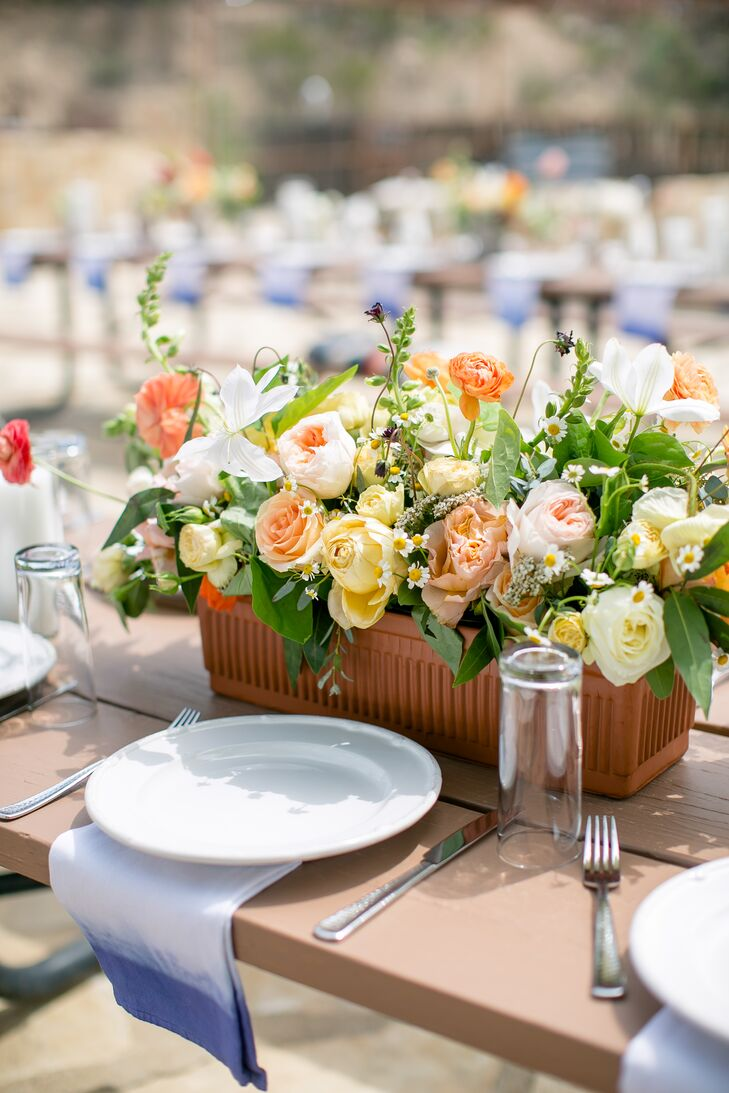 Peach garden rose and ranunculus centerpiece