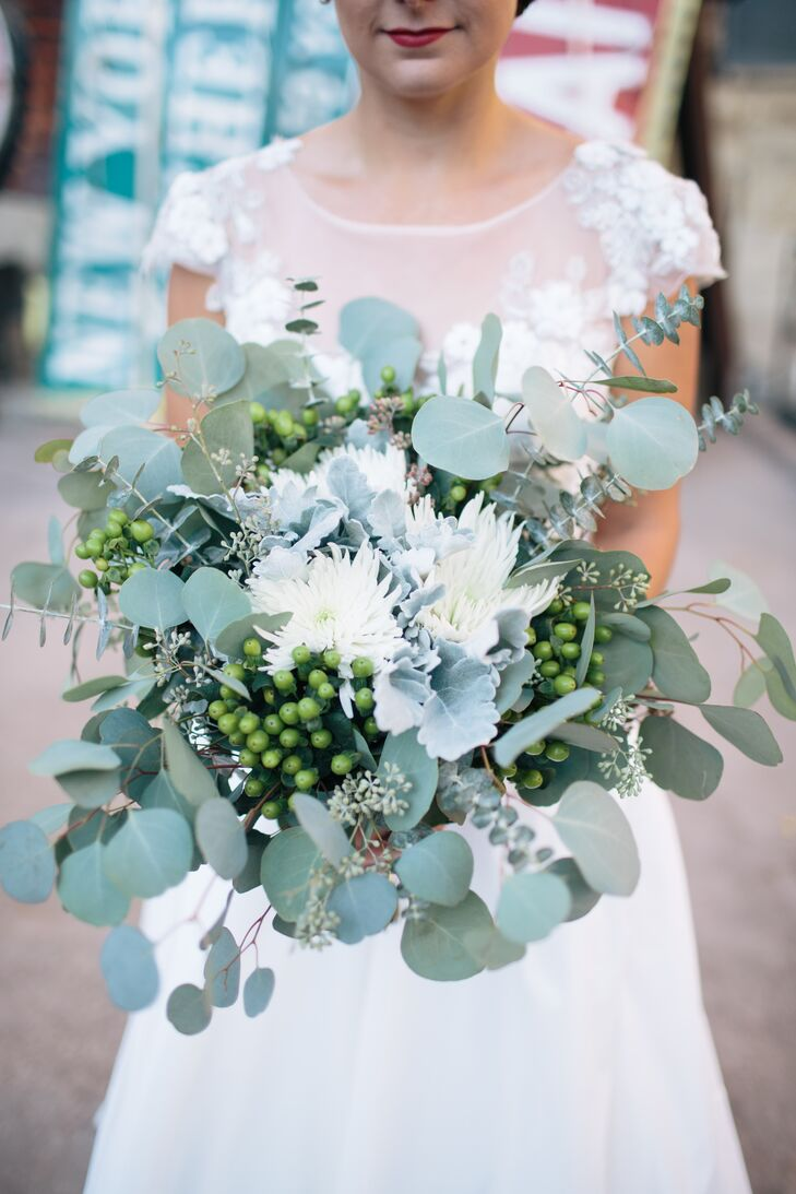 """Our florist, A Pretty Flower, completely understood my vision and helped me create these lush, green, fragrant bouquet full of eucalyptus, mums and lamb's ear,"" the bride says."
