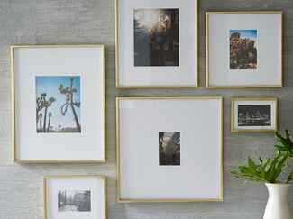Polished brass photo frames from West Elm