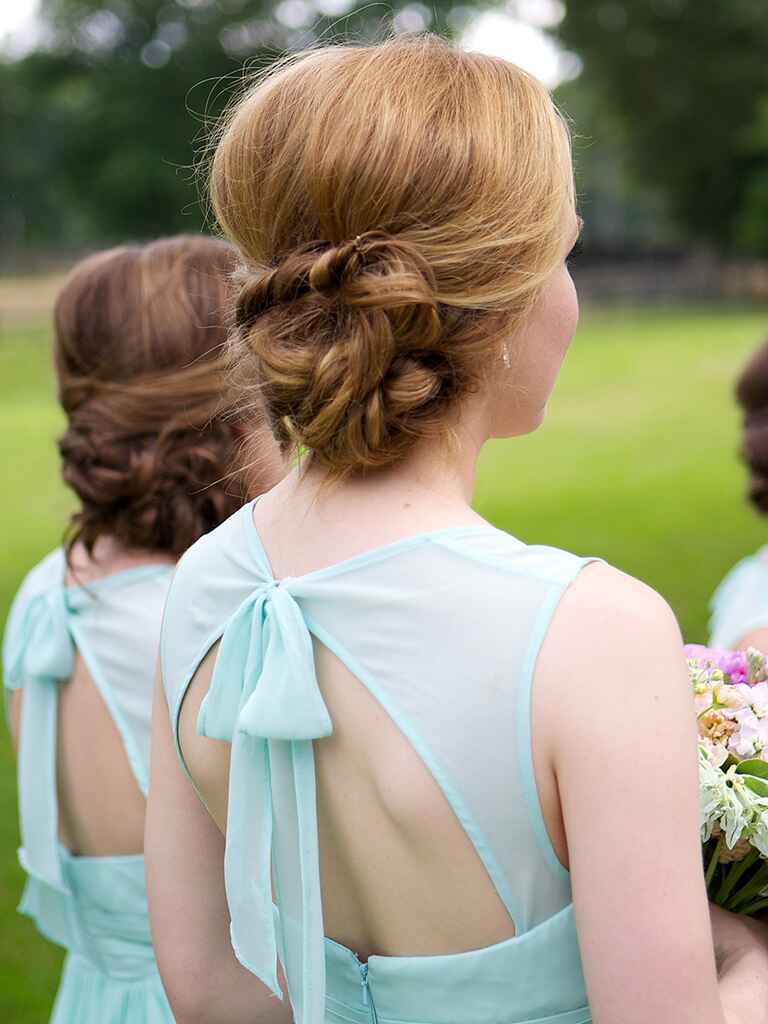 Messy low bun hairstyle idea for brides or bridesmaids