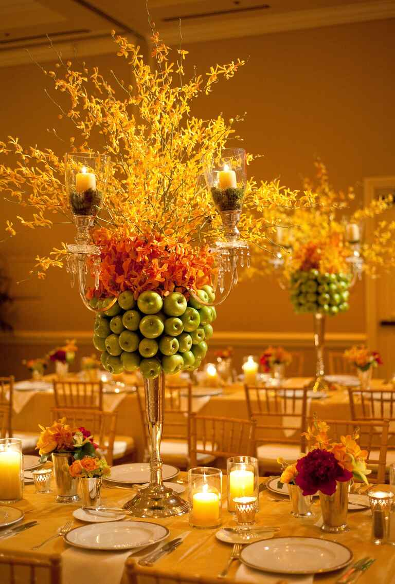 Granny Smith apple and forsythia tall wedding centerpiece