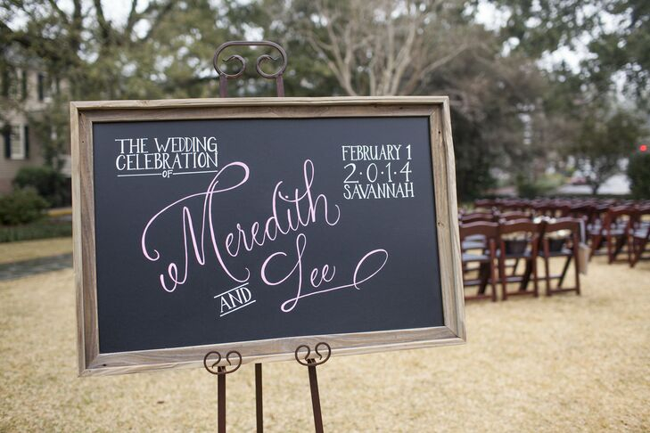 The couple placed a wooden-framed, chalkboard-like sign at the ceremony to welcome guests.