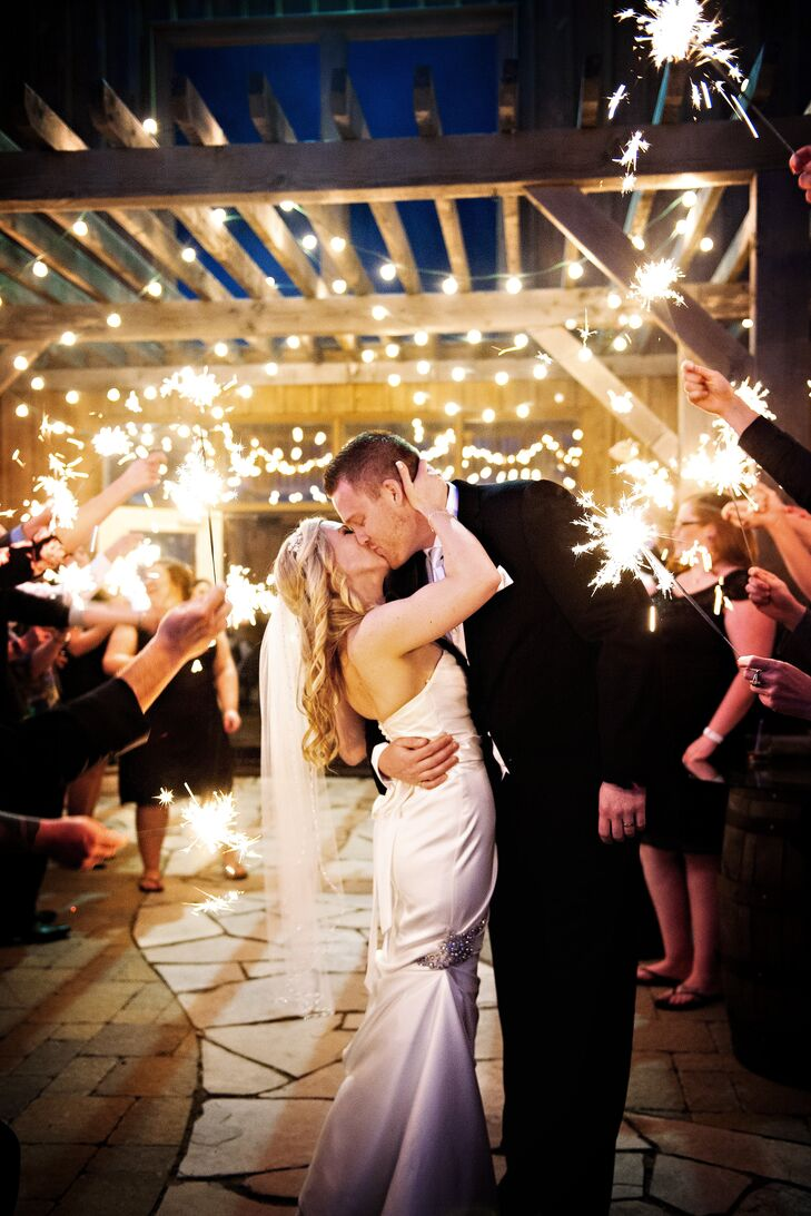 Jennifer Newberry Photography snapped photos of the couple at the end of the reception surrounded by guests holding sparklers above them.