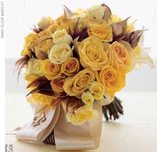 Yellow and gold bouquet tied with a fleur-de-lis ribbon