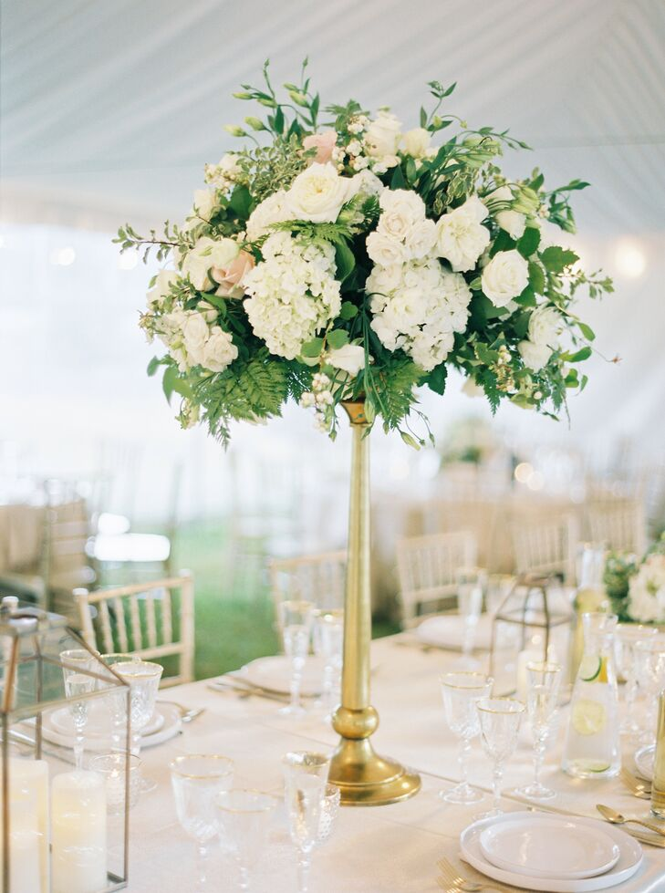 One single tall centerpiece for the reception table design is all that's needed to make a statement.
