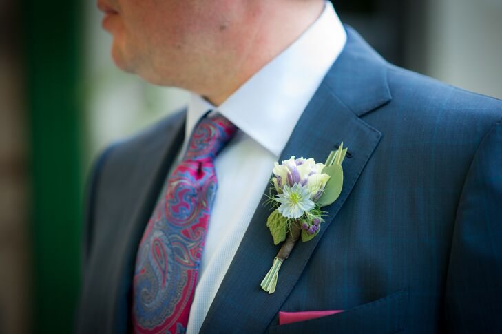 James and Stephen wore suits instead of tuxedos. Stephen wore a blue-gray suit with a red and navy paisley tie and a matching red pocket square. He pinned a purple and white boutonniere to his lapel to complete the look.